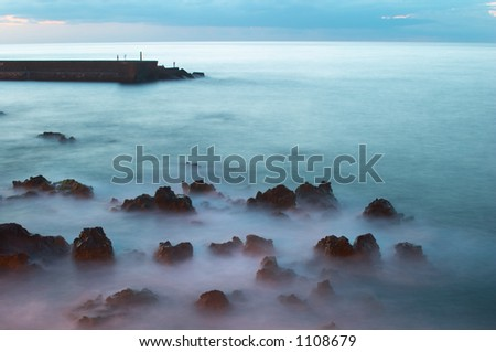 Beacon at sunset, Puerto de la Cruz, Tenerife - stock photo