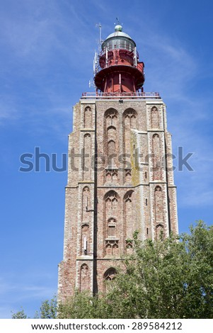 beacon on a top of a church tower, Weskapelle, The Netherlands - stock photo
