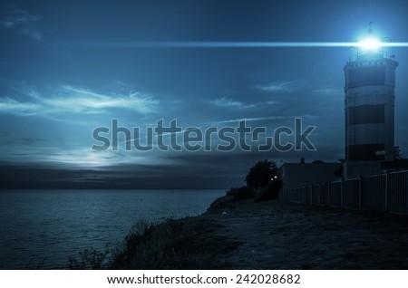 Beacon on the island at night - stock photo