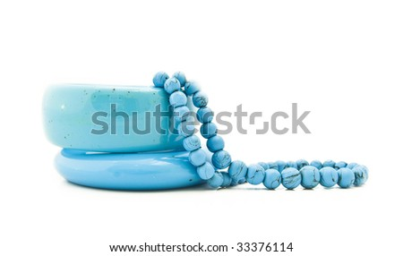 Beads and bracelets from turquoise on a white background - stock photo