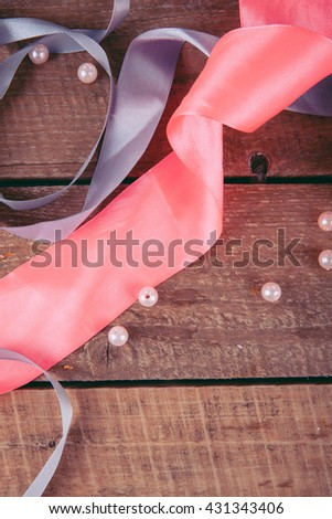 beads and ribbons on a wooden background