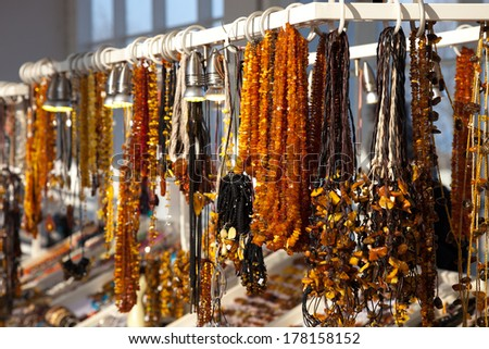 Beads other handcraft jewelry made of stone amber.  - stock photo