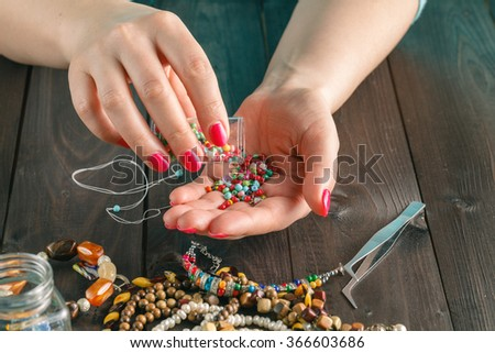 beads, scissors, and tools for creating fashion jewelry in the manufacturing process
