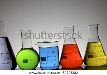 beakers group with liquid against a white background