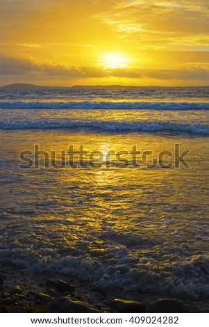 beal beach near ballybunion on the wild atlantic way ireland with a beautiful yellow sunset - stock photo