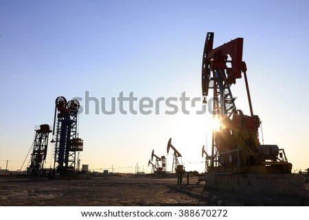 Beam balanced pumping unit under the setting sun in oilfield