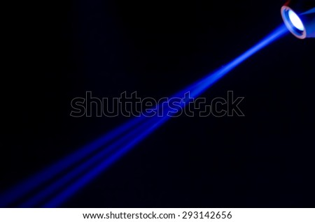Beam of blue light on black background. Applied to a searchlight, torch.
