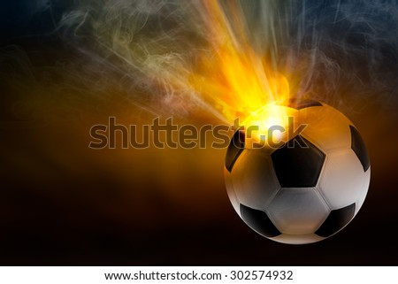 Beam of fire blaze with smoke burst out from internal soccer ball in shooting concept - stock photo