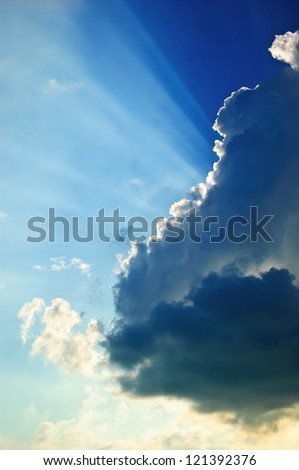 Beam out of the blue cloud./Beam - stock photo