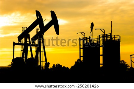 Beam Pumping unit oil and gas Silhouette - stock photo