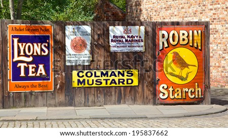BEAMISH, UK - JULY 27, 2012: Antique advertising boards at Beamish Museum, an open-air museum that tells the story of life in North-East England in Georgian, Victorian and Edwardian times.  - stock photo