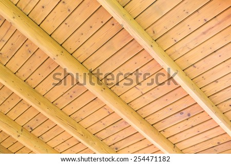Beams structure on the wooden ceiling of a new home - stock photo