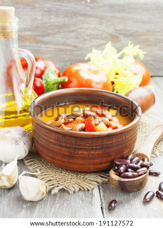 Bean soup with tomato, celery and peppers on the table