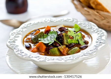 Bean with zucchini and carrot soup - stock photo