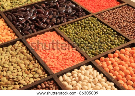 Beans and cereals - colorful bean boxes. Decorative food abstract.