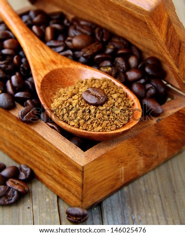 beans and ground coffee in a wooden box - stock photo