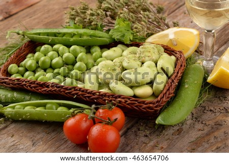 Beans and organic pea on wooden table