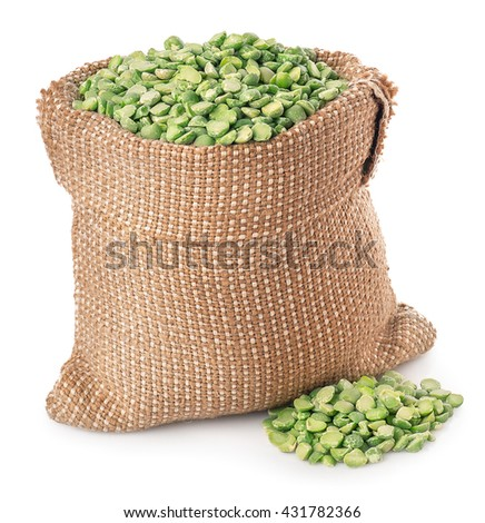Beans in burlap sack with heap isolated on white background. Split peas in burlap bag  - stock photo