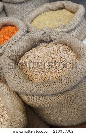Beans, rice, lentils, oats, wheat, rye and barley in jute sack - stock photo