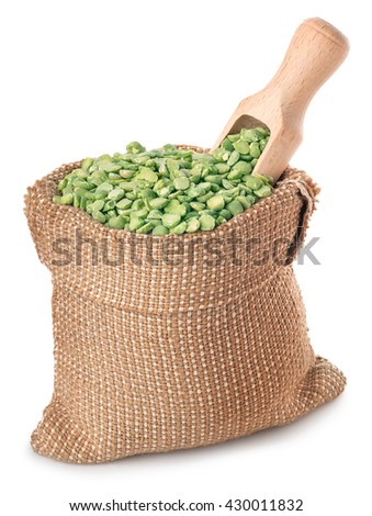 Beans with wooden scoop in burlap sack isolated on white background. Split peas in burlap bag  - stock photo