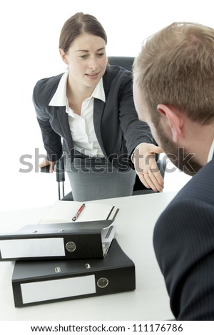 beard business man brunette woman at desk ask  sit down