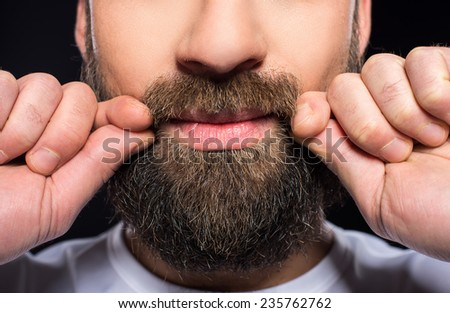 Beard man. Close-up cropped image of bearded mans face isolated on black. - stock photo