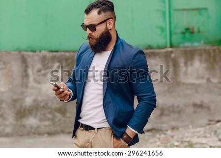 beard man with phone - stock photo