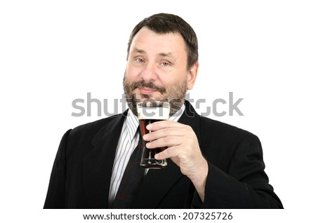 Bearded cheerful man in suit holding ale glass in left hand