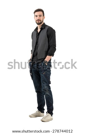 Bearded fashion male model looking up with hands in pockets. Full body length portrait isolated over white background.  - stock photo