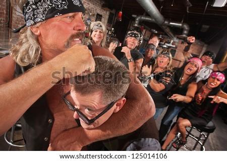 Bearded gang member holding nerd in a head lock - stock photo