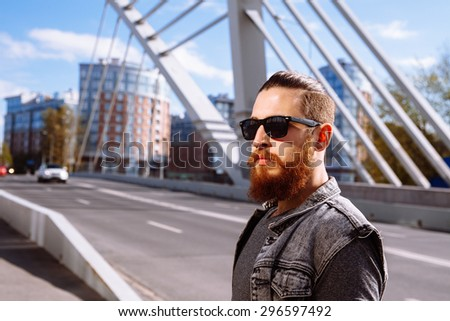 Bearded hipster wearing sunglasses in the city outdoor