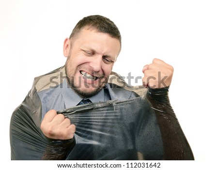 Bearded man breaks the plastic bag on white background, concept, metaphor