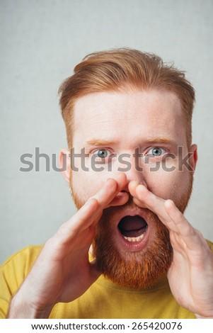 bearded man calling someone - stock photo