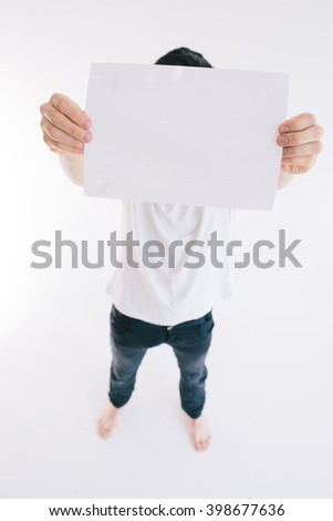 Bearded man holding a blank white sheet of paper isoladed on white