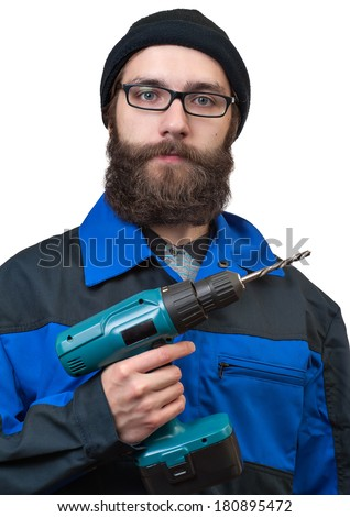 bearded man holding in a hand the electric drill - stock photo