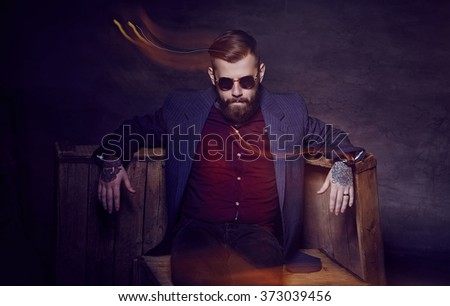 Bearded man in a suit and sunglasses. - stock photo