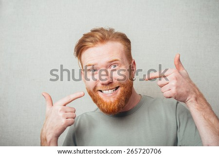 Bearded man smiling gesture shows the white teeth - stock photo