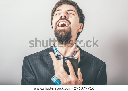 bearded man upset after talking on the phone - stock photo