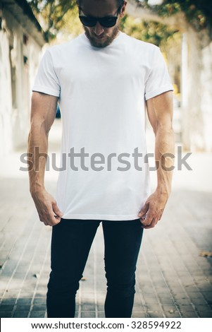 Bearded man wearing white blank t-shirt and blue jeans  - stock photo