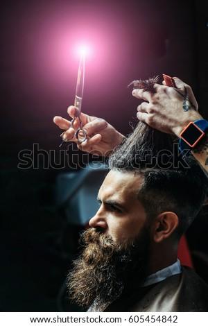 How To Trim Mens Long Hair With Scissors : Haircut at barbers. beautiful blonde woman cutting mens dark