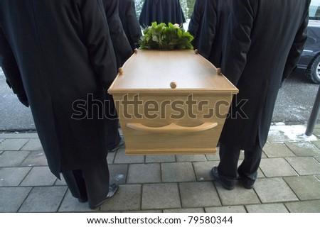 Bearers a carrying a coffin - stock photo