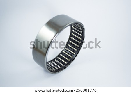 Bearing cage with silver cover on white background - stock photo