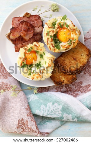 beaten egg cooked in the oven with bacon and toast.