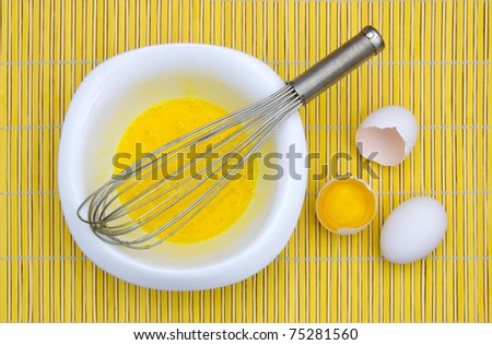 beaten eggs in a bowl - stock photo