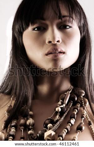 Beatiful face of asian woman on white studio background - stock photo