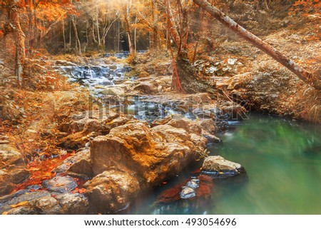 Beatiful of waterfall in colorful autumn forest with sun ray, Saraburi, Thailand