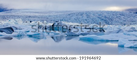Beatufil vibrant picture of icelandic glacier and glacier lagoon with water and ice in cold blue tones, Iceland, Glacier Bay  - stock photo
