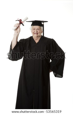 Beauitiful Caucasian Senior Citizen in a black graduation gown holding a diploma isolated on a white background - stock photo