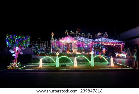 BEAUMONT HILLS, AUSTRALIA - DECEMBER 24, 2015;  Christmas lights decorations on house  draw crowds of visitors each year.  The Christmas display raise money for charity by donations of visitors.  - stock photo
