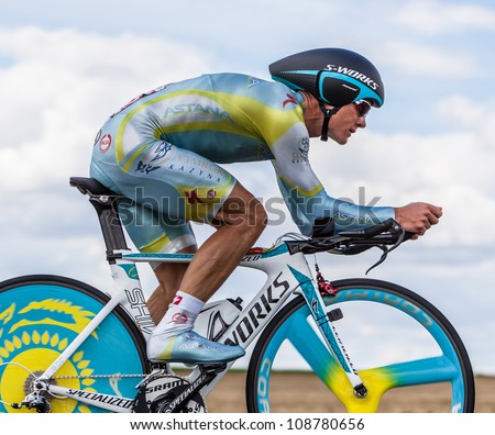 BEAUROUVRE,FRANCE,J UL 21:Vinokourov Alexandr, the winner of the gold in the Olympic Men's Road Race in London, pedaling in the 19 time trial stage of Le Tour de France on July 21 2012. - stock photo